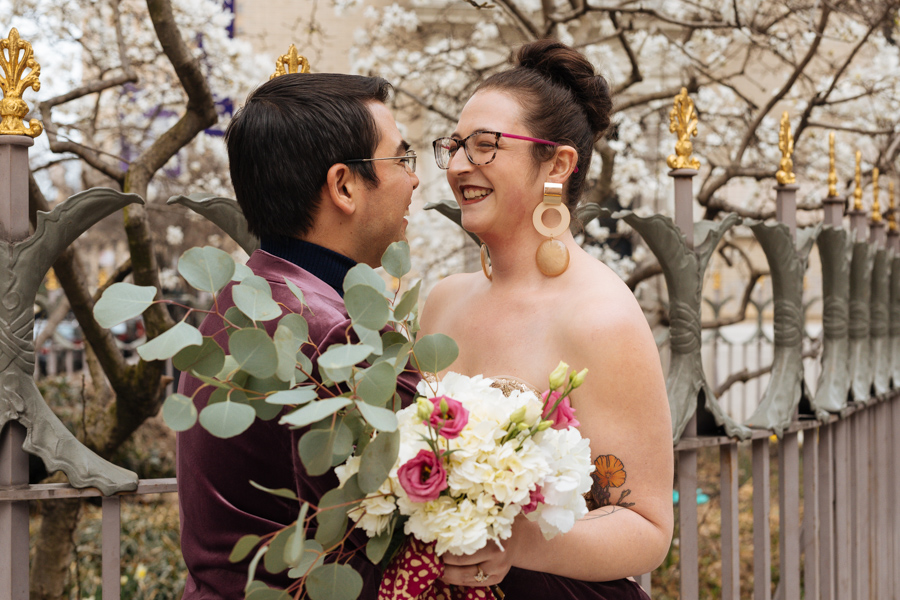 Bride and groom laugh together during their East Village elopement