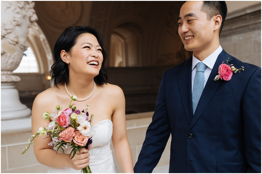 Couple having fun and laughing during their San Francisco City Hall wedding