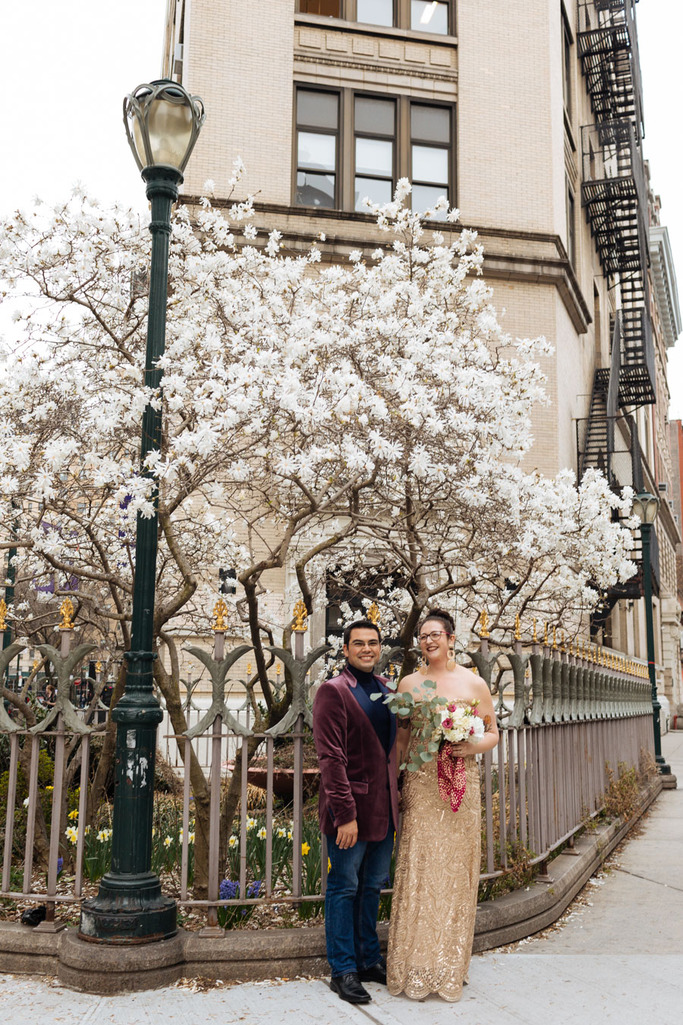 Bride and groom hold hands during their East Village elopement in NYC