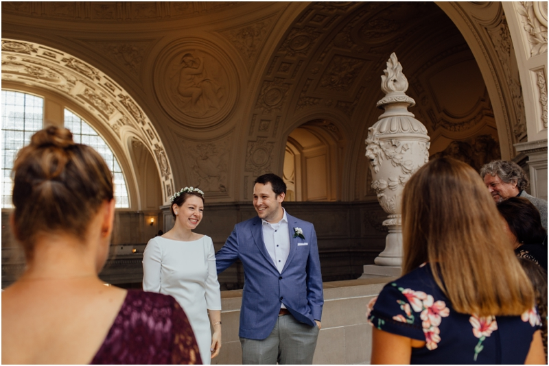 Couple smiles after their San Francisco City Hall wedding during Pride Week