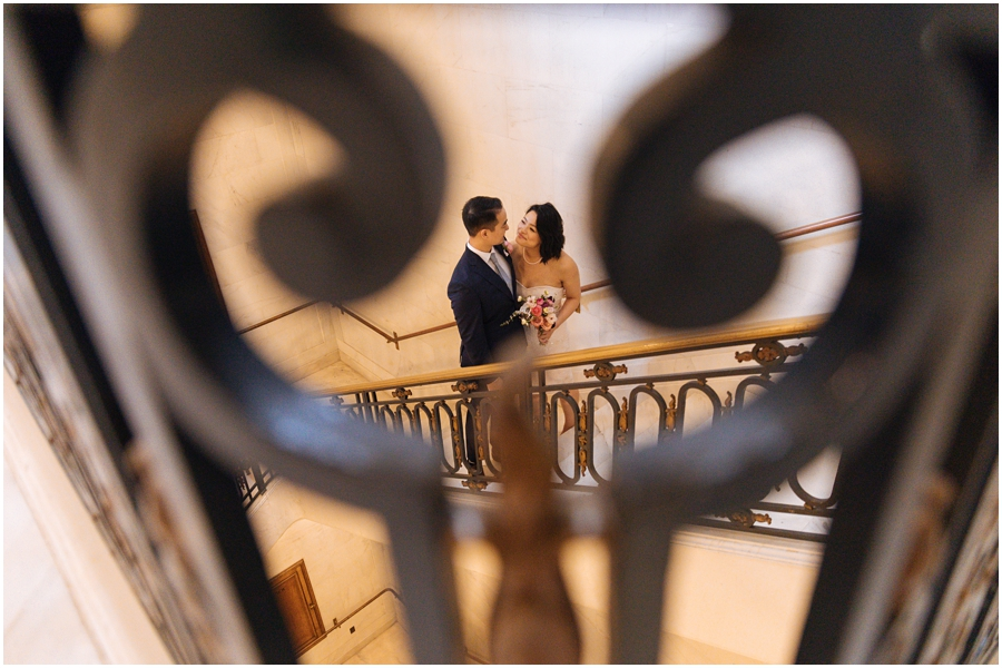 Bride and groom in the stairwell at San Francisco City Hall