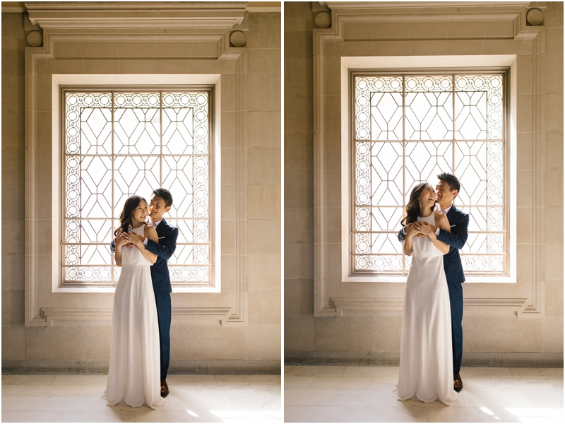 Couple laughs together during their San Francisco City Hall wedding