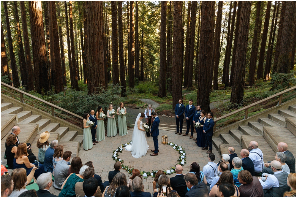 Married couple stands in the redwoods at their redwood wedding venue ceremony site, the Berkeley Botanical Garden, Berkeley