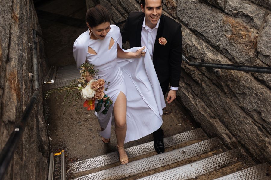 Bride and groom head up the steps to the Brooklyn Bridge during their Brooklyn elopement